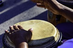 Drum player at samba performace. Drum player playing atabaque during presentation of afro music on the eve of the Brazilian carnival Royalty Free Stock Image