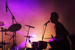 Drum player silhouette on the stage Stock Photo
