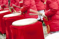 Drum playing on happy moment. Drum playing in Asia on a happy moment ,people wear red clothes Royalty Free Stock Images