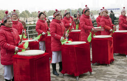 Drum playing on happy moment. People wear red clothes play drums playing in Asia on a happy moment .They celebrate the begin of a horse riding race. Photo taken Stock Images