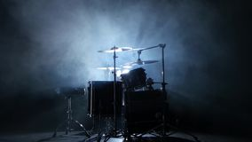 Drum professional installation in the studio. Black smoky background. Back light. Professional installation of the drum with all the inventory, chopsticks stock video