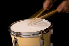 Drum roll. Played on a tom drum; motion blur of sticks and hands; isolated on black stock photography