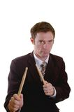 Drum roll man. Business man drumming up sales with a drumstick roll Stock Photography