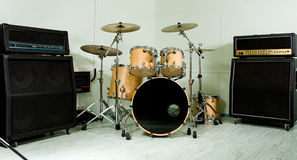 Drum set. And amplifier in studio Royalty Free Stock Images