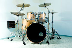 Drum set. In blue studio stock images