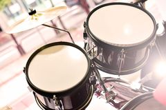 Drum set for children against a window outdoors royalty free stock photography