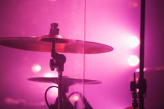 Drum set with cymbals in red stage lights. Live music photo background, rock drum set with cymbals in red stage lights. Closeup photo, soft selective focus royalty free stock images