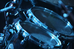 Drum set, lit by blue. Rock concert series: drum set with microphones, lit by blue Stock Images