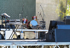 Drum set, microphones and speakers on stage. Ready for concert Royalty Free Stock Images