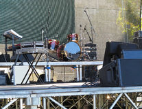 Drum set, microphones and speakers on stage. Ready for concert Royalty Free Stock Photography
