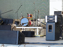 Drum set, microphones and speakers on stage. Ready for concert Royalty Free Stock Photo