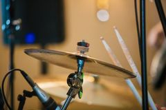 Drum Set with plates and sticks during the concert. Close royalty free stock photography