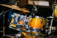 Drum Set with plates and sticks during the concert. Close royalty free stock photo