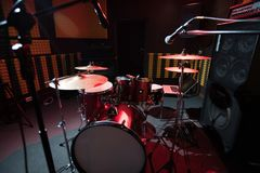 Drum Set in Record Studio. Background of modern profession drum set in dark recording studio, copy space stock photo