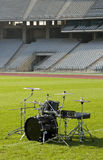 Drum set at the Stadium. Empty Olympic Stadium and a drum set on green grass field Stock Photography