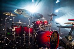 Drum set on stage and light background; empty stage with instrum. Ents ready for performance Royalty Free Stock Image