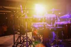 Drum set on stage and the light stock images