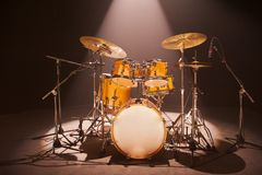 Drum-Set on Stage. Musicians Drum-set illuminated by stage light royalty free stock photography