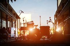 Drum set on stage, silhouette Stock Photos
