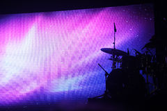 Drum set on stage. To lighting backdrop stock photo