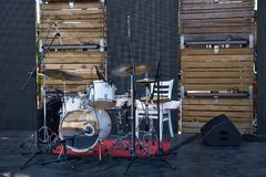 Drum set-up on stage horizontal. Musical instruments on stage, ready for the gig. Drum set-up on stage horizontal Stock Image