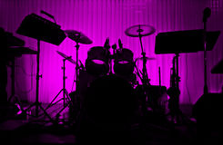 Drum in silhouette with no musician. Stock Image