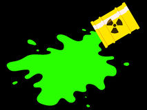 Drum with spilled green radioactive liquid Royalty Free Stock Image