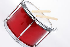 Drum with sticks. A red toy snare drum with drum sticks Royalty Free Stock Photography