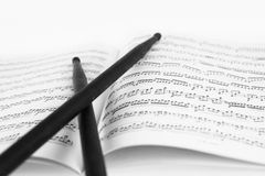 Drum sticks. On the music sheet stock photos