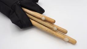 Drum sticks and black bags. Stock Image