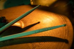 Drum sticks and cymbals, studio shot. With selective focus royalty free stock photos