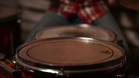 Drum sticks hitting the drum closeup stock footage