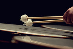 Drum sticks hitting the timpani stock photo