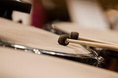Drum sticks hitting the timpani Stock Photo