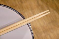 Drum sticks lay on an drum set Stock Photos