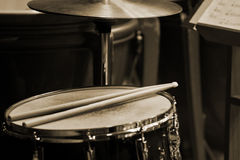 Drum sticks lying on the drum Royalty Free Stock Images