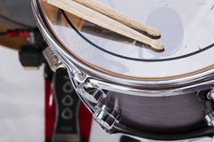 Drum Sticks Prepared For Playing. A set of drum sticks on a snare drum ready for playing stock photo