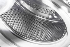 Drum washing machine. Perforated drum of an automatic washing machine sparkles in the light Royalty Free Stock Images