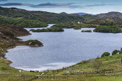 Drumbeg lake behind the hamlet, Scotland. Stock Image