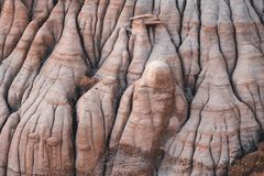 Drumheller HooDoos is a 0.5 kilometer heavily trafficked loop trail located near Drumheller, Alberta, Canada that features a cave royalty free stock photo