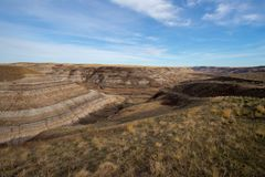 Drumheller HooDoos is a 0.5 kilometer heavily trafficked loop trail located near Drumheller, Alberta, Canada that features a cave royalty free stock images