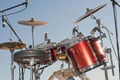 Drumkit against a blue sky background Stock Photo