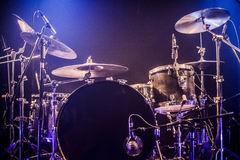 Drumkit on empty stage waiting for musicians Stock Photos