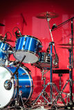 Drumkit in front of Blue Background Royalty Free Stock Photo