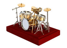 Drumkit miniatura su un fondo bianco Immagini Stock