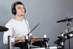 Drummer. Behind drum-type installation Stock Image