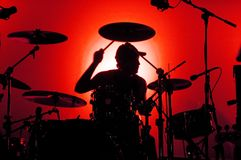 Drummer. Silhouette of a drummer in a red background Royalty Free Stock Images