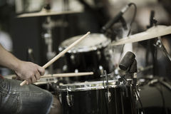 Drummer. Detail of a drummer on the rock concert, selective focus on hands stock photography