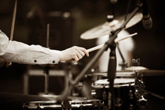 Drummer. Detail of a drummer on the rock concert, selective focus on hands stock images