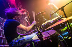Drummer. (blurred motion) playing on drum set on stage. Focus on the drum and microphone stock photography